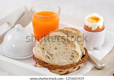 bread with boiled egg and fresh orange juice