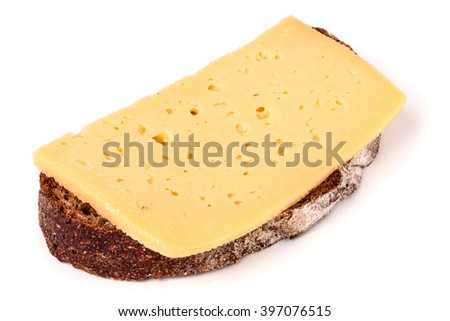 Bread with butter and sliced cheese on white background