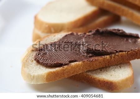 bread with chocolate cream - stock photo