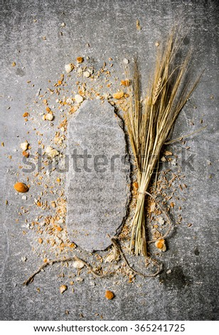 Bread with ears of wheat and a stone stand. On the stone table. Free space for text . Top view - stock photo