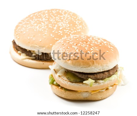 Bread with fried meat, cheese, onion, lettuce and measuring tape isolated on a  white background.