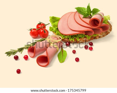 Bread with ham and tomato / studio photo of meat products  - stock photo