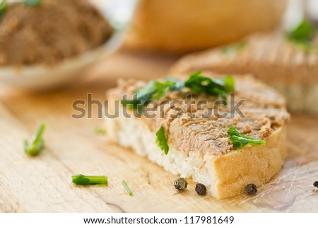 bread with homemade liver pate and herbs - stock photo