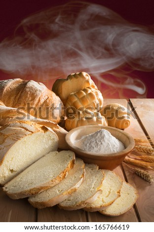 bread with ingredients on the wooden table - stock photo