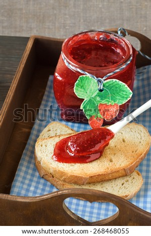 bread with jam for breakfast - stock photo