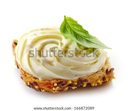 bread with melted cream cheese isolated on a white background - stock photo