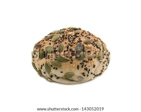 Bread with mixed seeds isolated on white