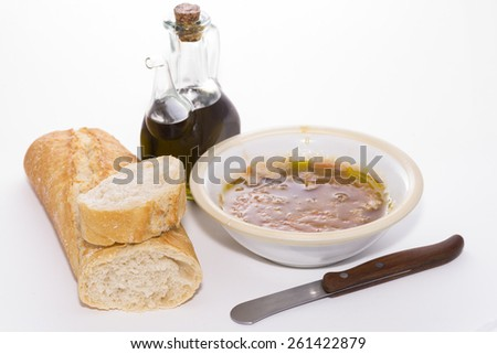 Bread with oil and tomato.