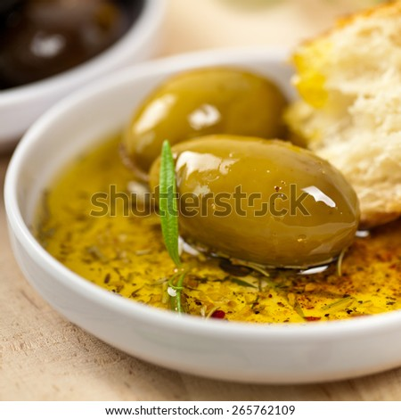 Bread with Olive Oil. Selective and soft focus.  - stock photo