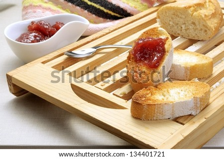 bread with red fruit jam - stock photo