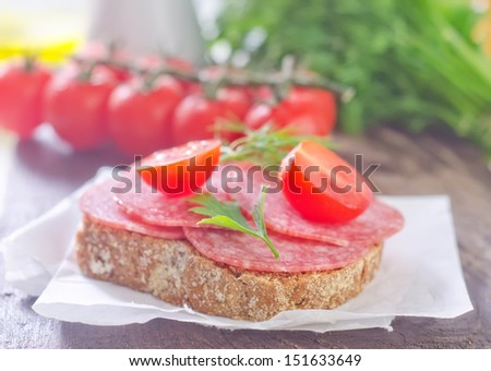 bread with salami and tomato - stock photo