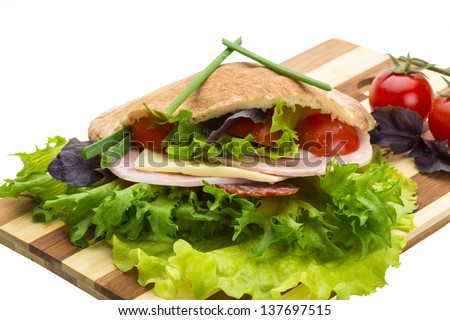 Bread with sausages and salad