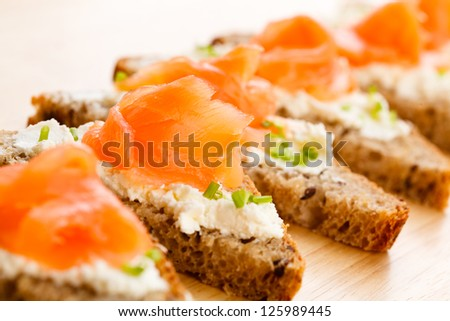 Bread with smoked salmon and cream cheese - stock photo