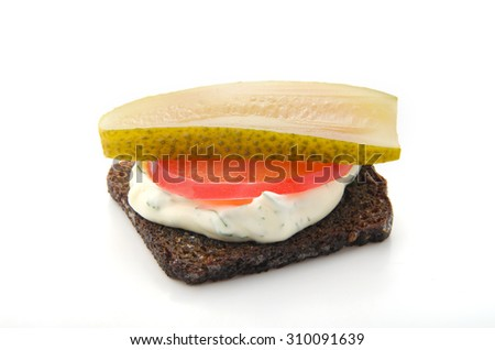 Bread with tomato, mayonnaise and chopped pickles on a white background
