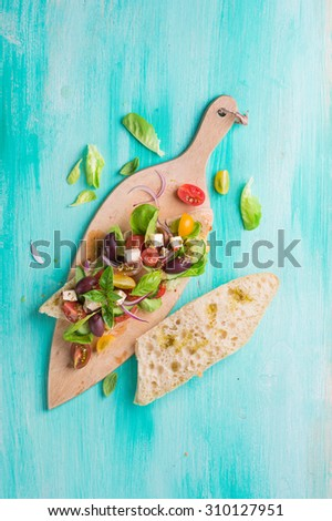 Bread with vegetable salad, cheese and olive, selective focus - stock photo