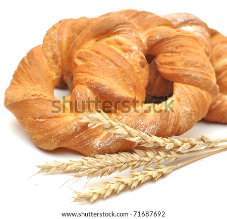 bread with wheat ears on white background