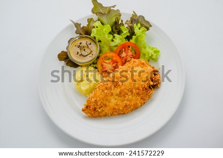 Breaded chicken with mashed potatoes and salad. - stock photo