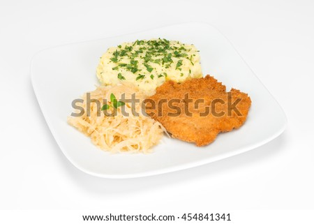 breaded fillet of chicken with fried cabbage and potatoes on the plate isolated on white background  - stock photo