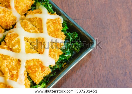 breaded fish fingers with mayonnaise on top
