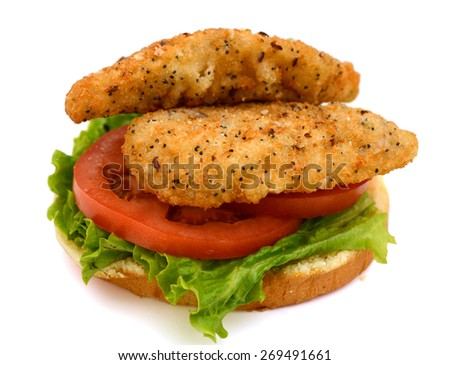 breaded fish with bun and vegetables isolated on white  - stock photo