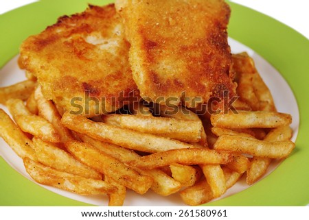 Breaded fried fish fillet and potatoes on plate background - stock photo
