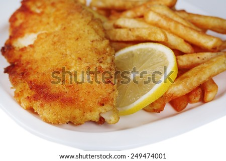 Breaded fried fish fillet and potatoes with sliced lemon on plate on white background - stock photo