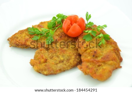 breaded pork chops on a plate