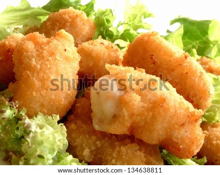 breaded scampi tails with salad leaves - stock photo
