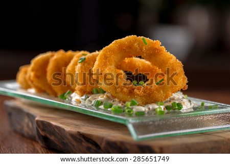 breaded squid rings with tartar sauce - stock photo