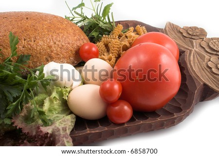 Breads and pasta, fresh herbs and tomato - stock photo