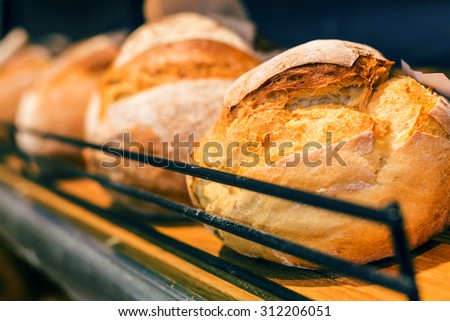 breads on the shelf in the bakery - stock photo