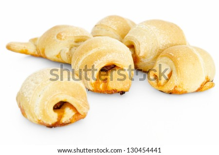 Breads rolls. Sausage bread. Sausage in the dough on white background, selective focus - stock photo