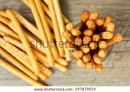Breadsticks grissini on wooden background