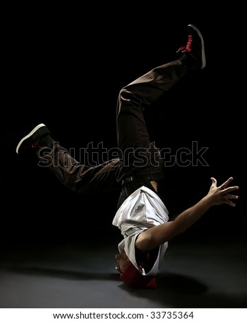 Break dance style dancer doing freeze position - stock photo
