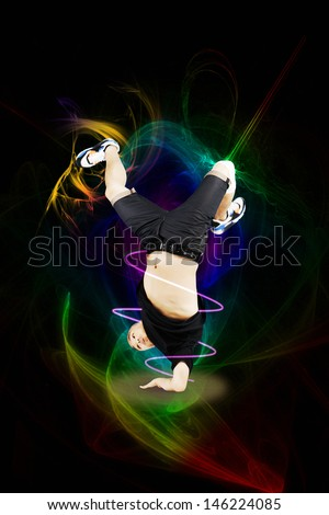 Break dancer on one arm over abstract background