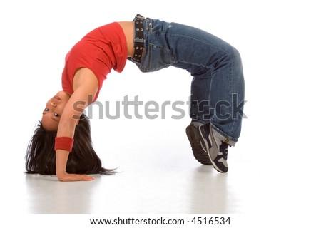 Break dancing girl in bridge pose (side view) - stock photo