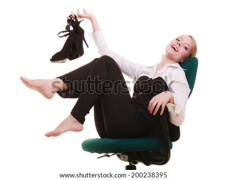 Break from work. Young businesswoman happy girl with shoes in hand relaxing on chair isolated on white. Business.
