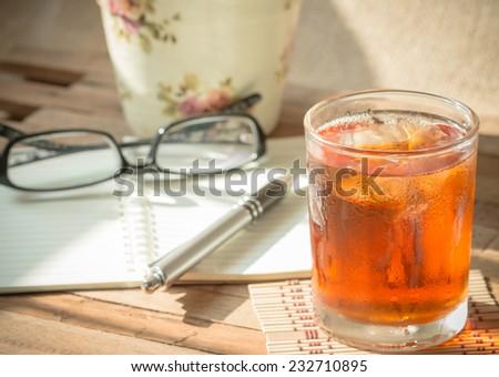 Break times with ice lemon tea on vintage tones - stock photo