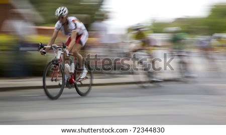 Breakaway shortly before the finish of the cycling race Around Funen. Motion blur. - stock photo