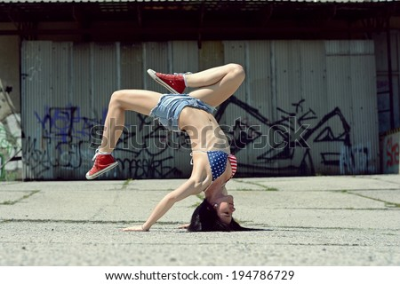 Breakdance girl on the street - stock photo