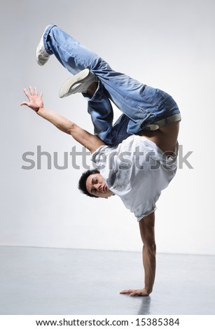 breakdance style dancer doing freeze position - stock photo