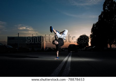 breakdanceing in the street - stock photo