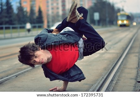 Breakdancer dancing in the city - stock photo