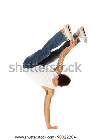 breakdancer does moves while perfoming a hand stand - stock photo