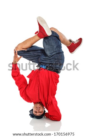 Breakdancer doing stand on arm and head - stock photo