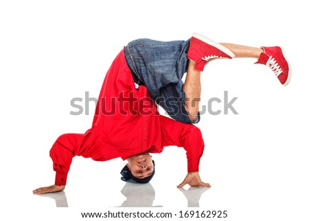 Breakdancer doing stand on arms - stock photo