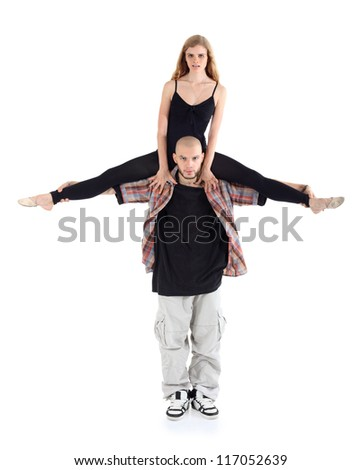 Breakdancer keeps on shoulders ballerina in black isolated on white background. - stock photo