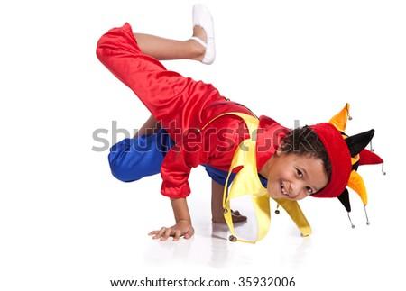 Breakdancing boy dressed in clown costume break a dance - stock photo