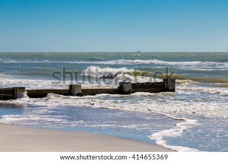 Breakers to prevent sand erosion on beach of Clearwater Florida - stock photo