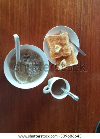 breakfast and hot coffee on a wooden table